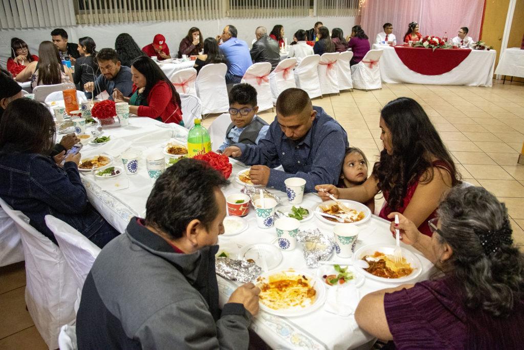 Kim Ramos' quinceañera party in the basement at Ministerio Hispano Presbyterian Church, Dec 14, 2019. (Kevin J. Beaty/Denverite)