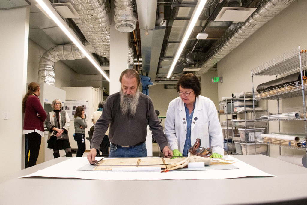 Gina Laurin and Steve Osborne fit a custom display mount for a 150 year-old Nukalk mask inside the Denver Art Museum's new restoration lab in the newly renovated Martin Building. Dec. 17, 2019. (Kevin J. Beaty/Denverite)