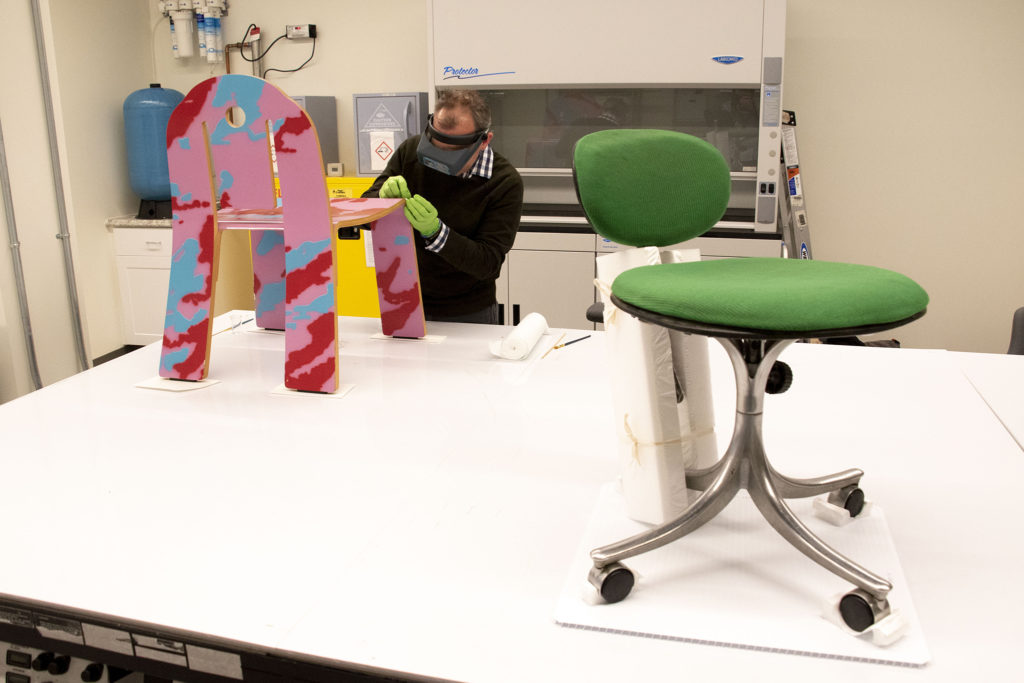 Conservator Aaron Burgess works hiding Deco 665 side chair by Robert Venturi inside the Denver Art Museum's new restoration lab in the newly renovated Martin Building. Dec. 17, 2019. (Kevin J. Beaty/Denverite)