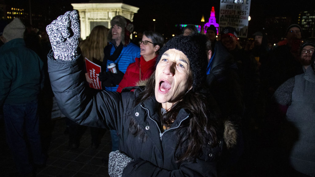 Brenna Hatmai screams a protest chant during a rally supporting the impeachment of President Donald Trump at the state Capitol, Dec. 17, 2019. (Kevin J. Beaty/Denverite)