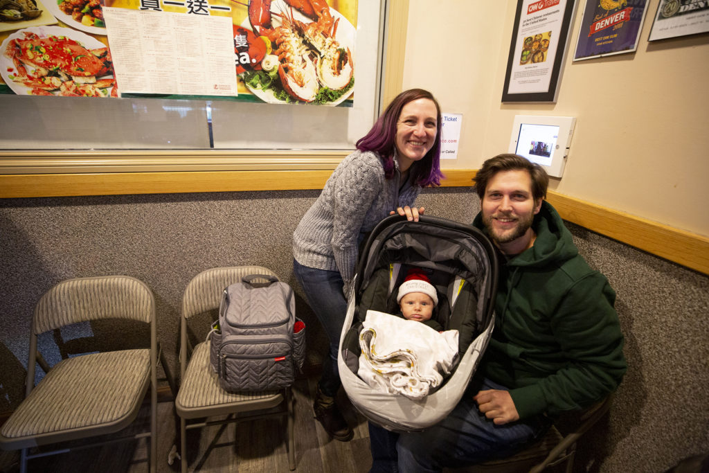 Hayley, Brett and Leo Truncali pose for a portrait as they wait to eat at Star Kitchen on Christmas Eve. Federal Boulevard, Dec. 24, 2019. (Kevin J. Beaty/Denverite)