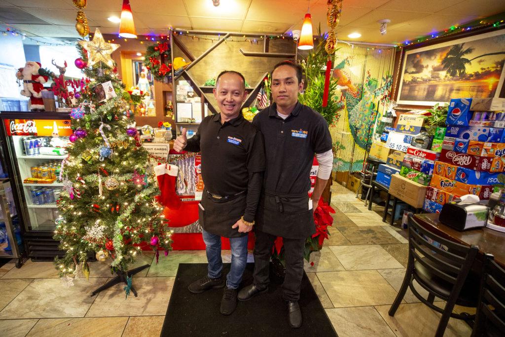 Tony Le and Duc Danh pose for a portrait inside Tony Pho on Christmas Eve. Federal Boulevard, Dec. 24, 2019. (Kevin J. Beaty/Denverite)