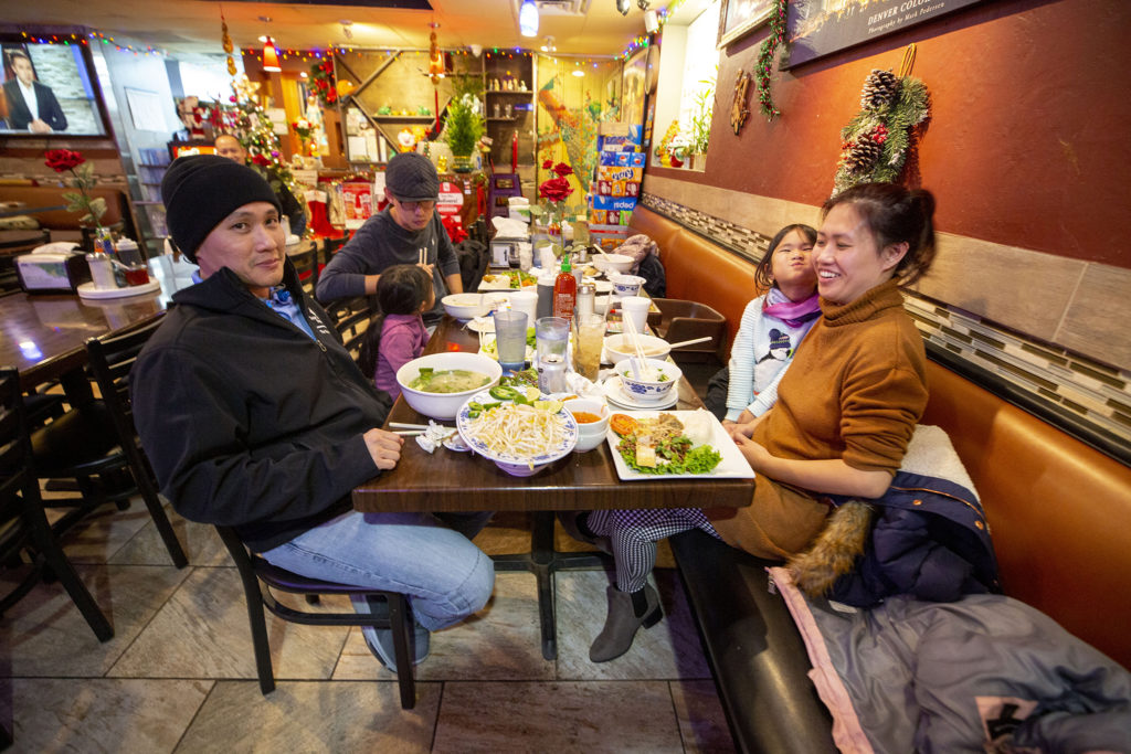 David Ngo and Linda Dang pose for a portrait during dinner at Tony Pho on Christmas Eve. Federal Boulevard, Dec. 24, 2019. (Kevin J. Beaty/Denverite)