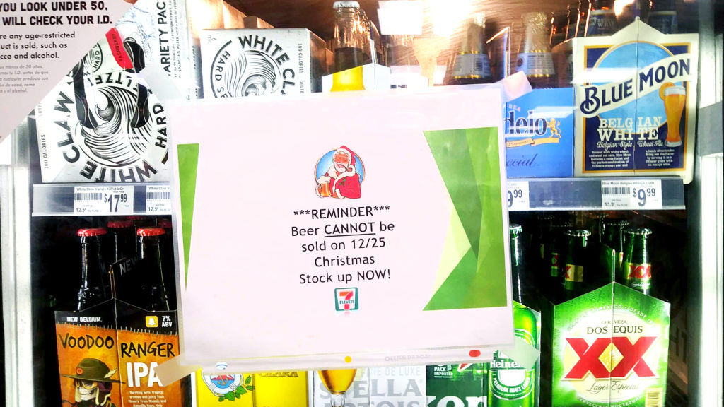 A reminder that beer sales are banned on Christmas Day on a 7-Eleven cooler. Dec. 26, 2019. (Kevin J. Beaty/Denverite)
