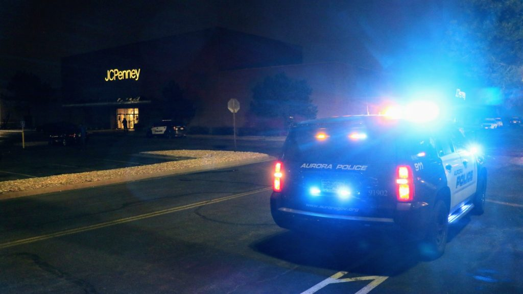 An Aurora police cruiser outside the Town Center at Aurora mall on Friday, Dec. 27, in Aurora. (Kevin J. Beaty/Denverite)