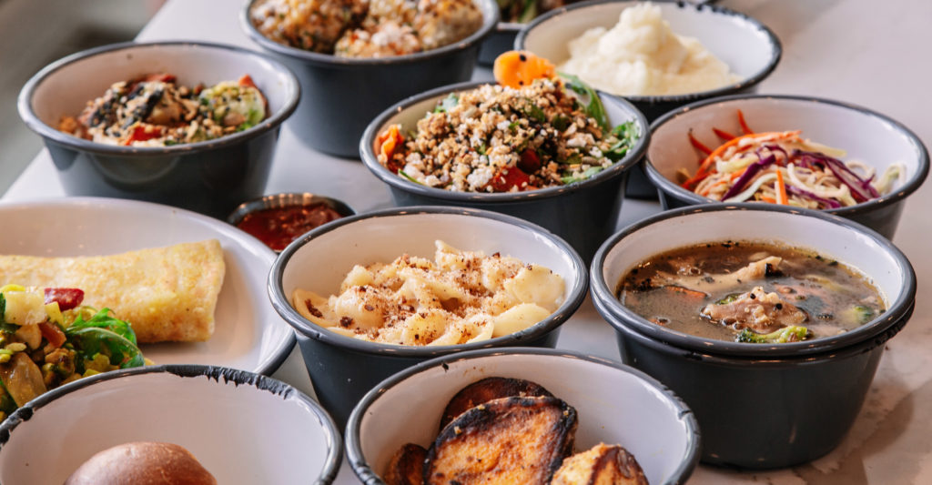 A collection of Chook's signature sides including potato wedges, slaw, Booyah chicken stew and more. (Dan Fogarty)