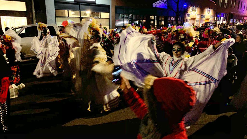 The Dia de Muertos parade along Santa Fe Drive on Friday, Nov. 1, in Denver. (Esteban L. Hernandez/Denverite)