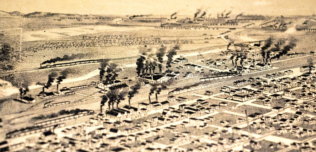 """Smokestacks """"belching smoke"""" highlight Denver's industrial growth in this 1889 aerial map of Denver in Wesley Brown's collection. Dec. 16, 2019. (Kevin J. Beaty/Denverite)"""