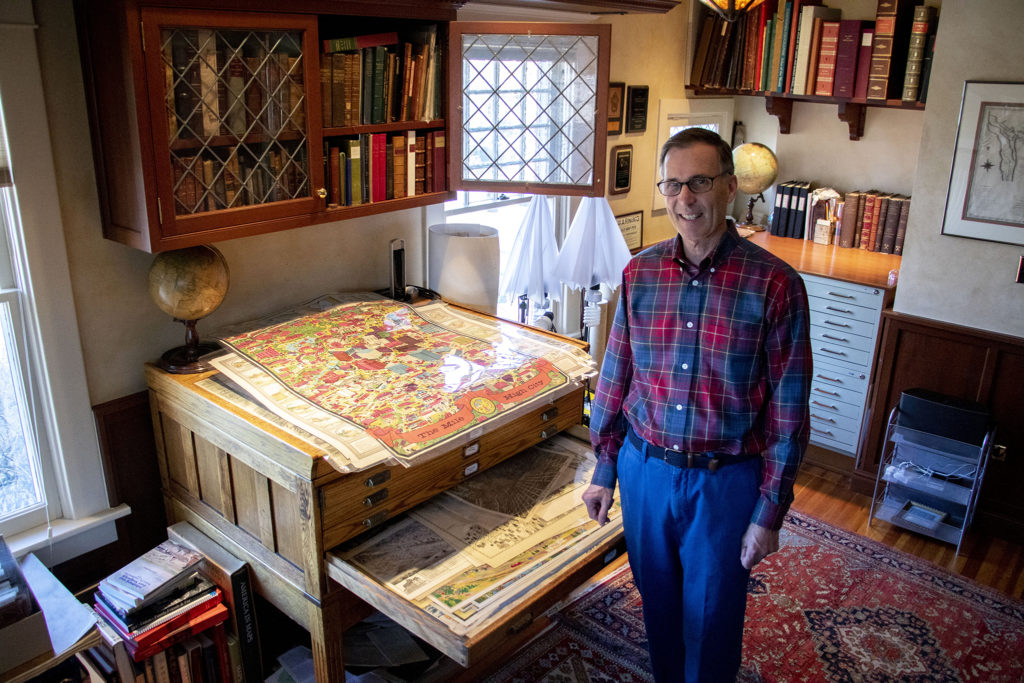 Wesley Brown in one of two rooms dedicated to his map collection in his South Park Hill home. Dec. 16, 2019. (Kevin J. Beaty/Denverite)