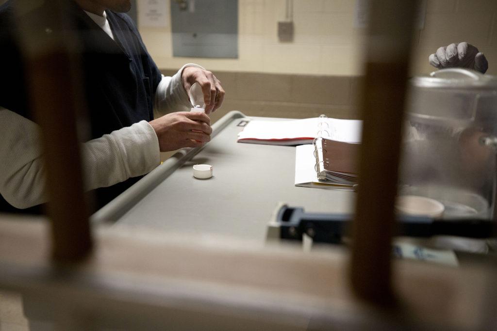 A Denver Health nurse distributes addiction medication to an inmate at the Denver County Jail, Jan. 9, 2020. (Kevin J. Beaty/Denverite)