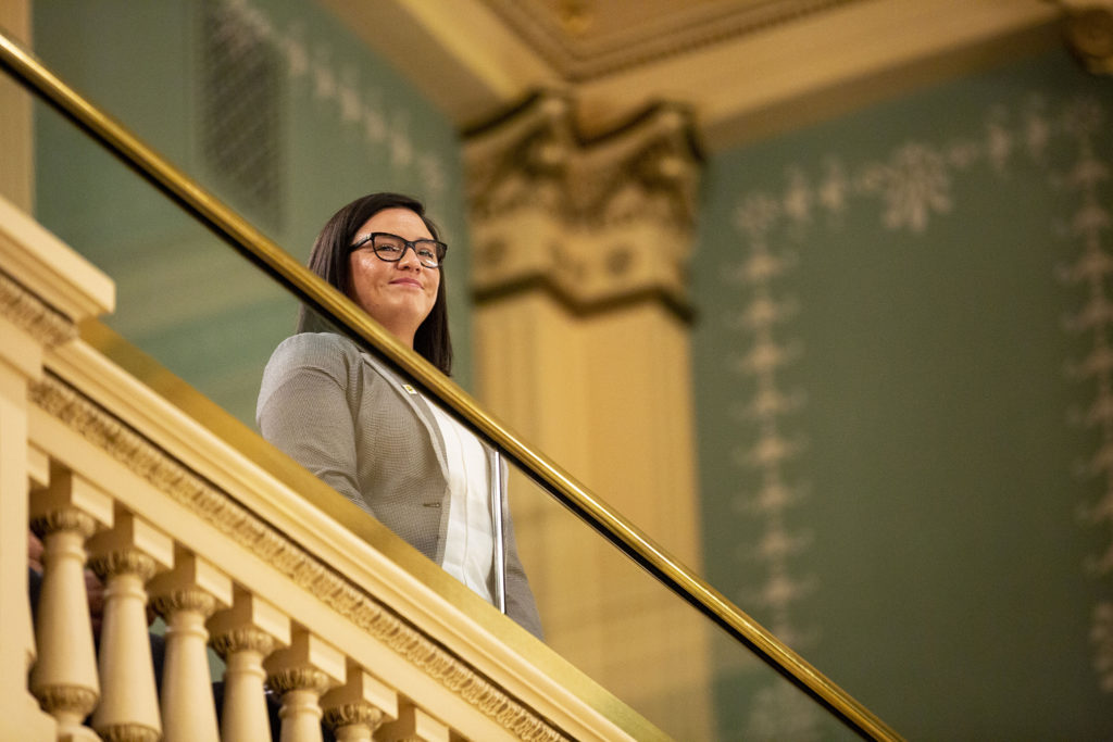 Marissa Molina beams as Gov. Jared Polis recognizes her, the first Dreamer to serve on a state board in Colorado, during his second State of the State address. Jan. 9, 2020. (Kevin J. Beaty/Denverite)