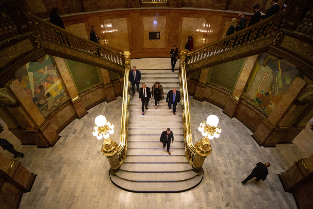 Gov. Jared Polis walks back to his office after his second State of the State address. Jan. 9, 2020. (Kevin J. Beaty/Denverite)