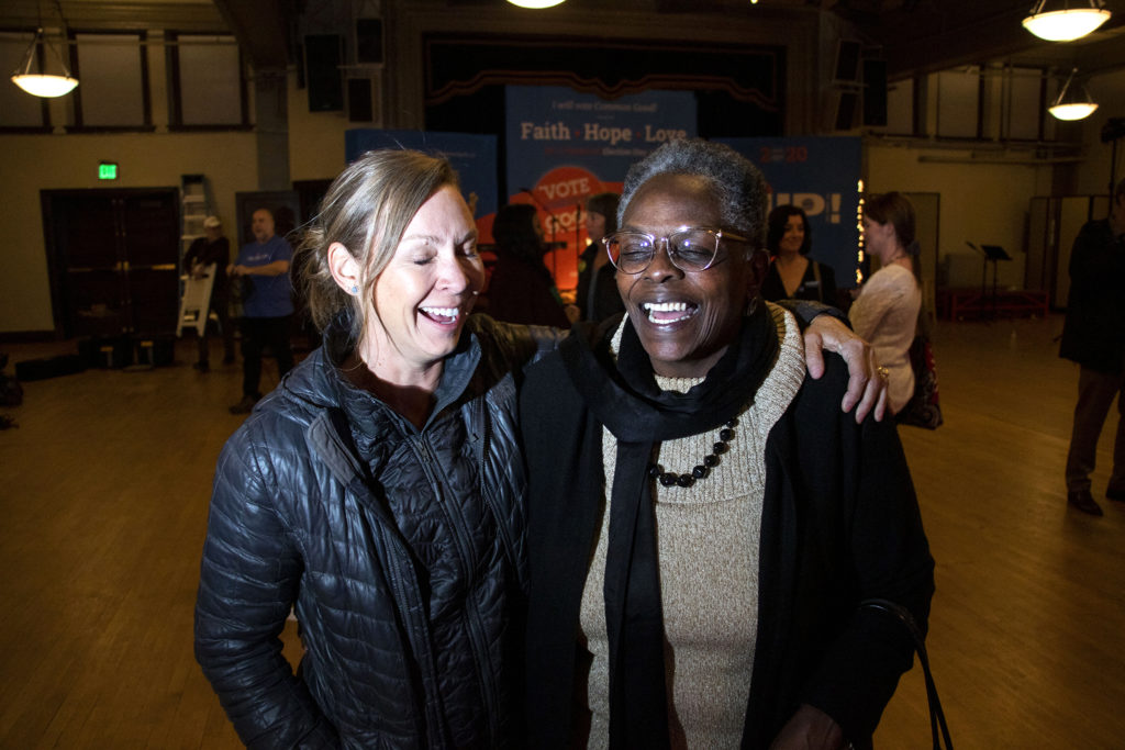 Rev. Amanda Henderson and Sharon Bridgeforth pose for a portrait during a political rally held by Vote Common Good at Denver Community Church. Jan. 14, 2020. (Kevin J. Beaty/Denverite)