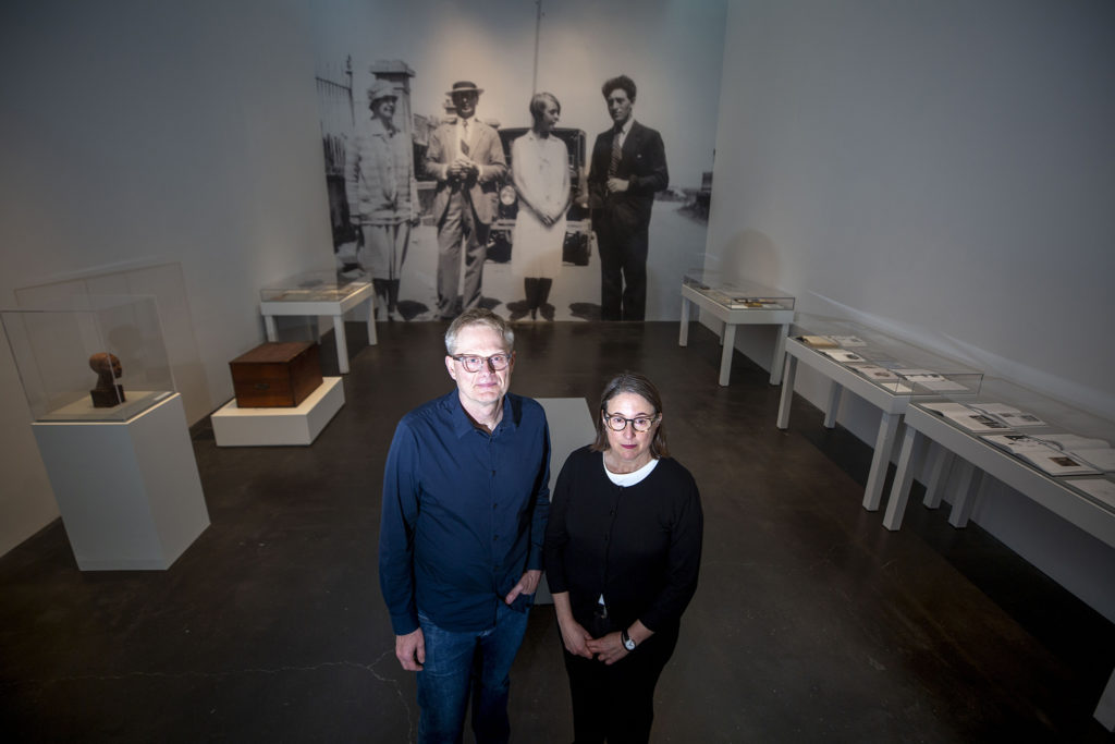 "Teresa Hubbard and Alexander Birchler pose for a portrait in their Museum of Contemporary Art installation, ""Flora."" Jan. 24, 2020. (Kevin J. Beaty/Denverite)"