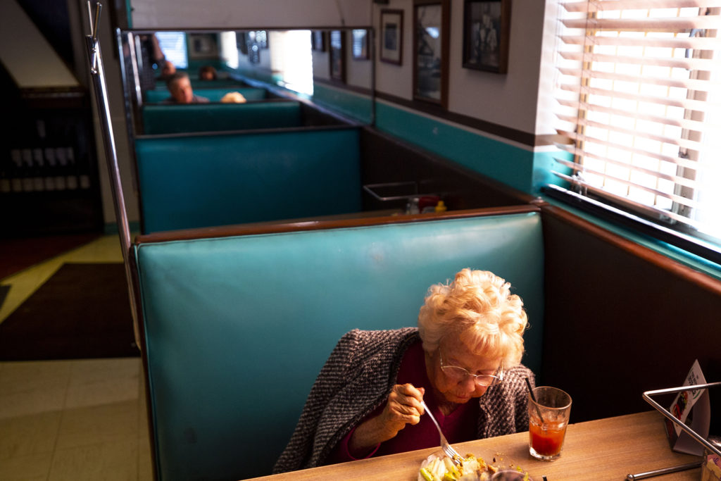 Harriet Moore has lunch with her son, Tom, at Bonnie Brae Tavern, Jan. 25, 2020. (Kevin J. Beaty/Denverite)