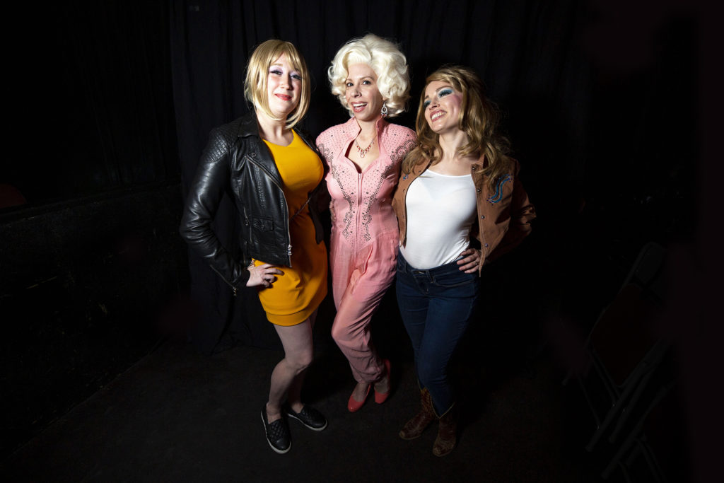 Erin Moohat, Megan Hickey and Tara McMurtry pose for a portrait during Dolly Day Denver, Jan. 26, 2020. (Kevin J. Beaty/Denverite)