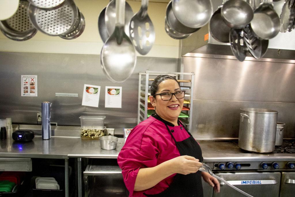 Kitchen supervisor Candi Vigil preps lunch at the Mental Health Center of Denver, Jan. 7, 2020. (Kevin J. Beaty/Denverite)