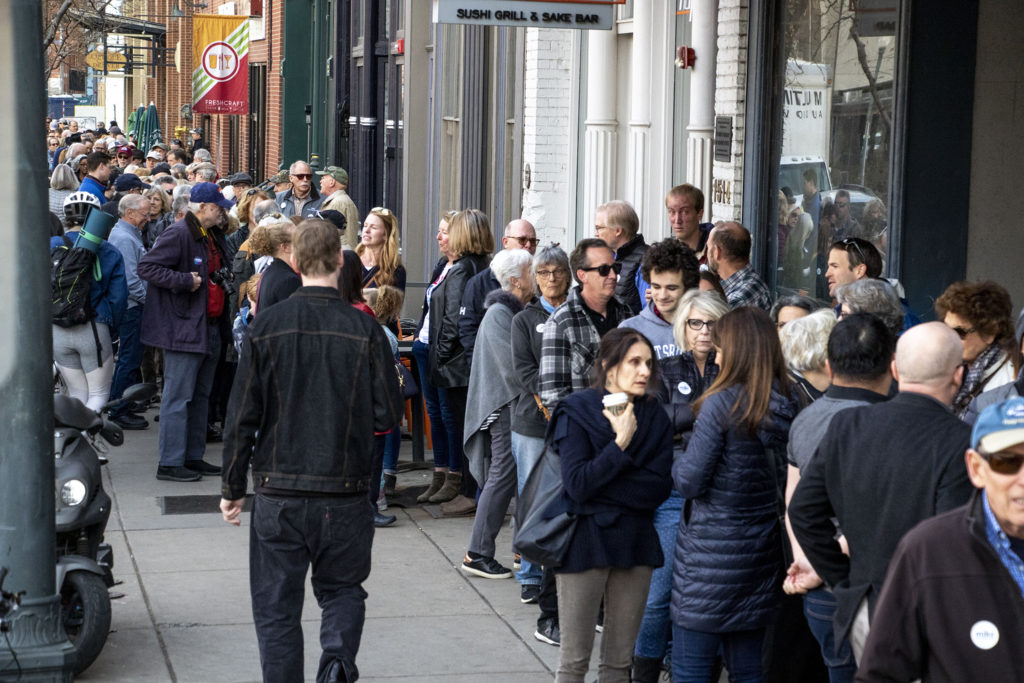 A line stretches around the block to see Mike Bloomberg speak at the opening of his new campaign office in downtown Denver, Feb. 1, 2020. (Kevin J. Beaty/Denverite)