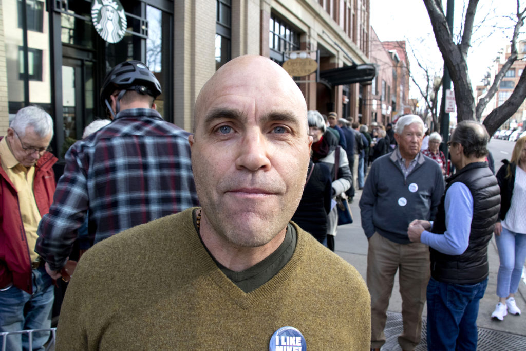 Tom Johnston poses for a portrait while he waits in line for Mike Bloomberg to open his new campaign office in downtown Denver, Feb. 1, 2020. (Kevin J. Beaty/Denverite)