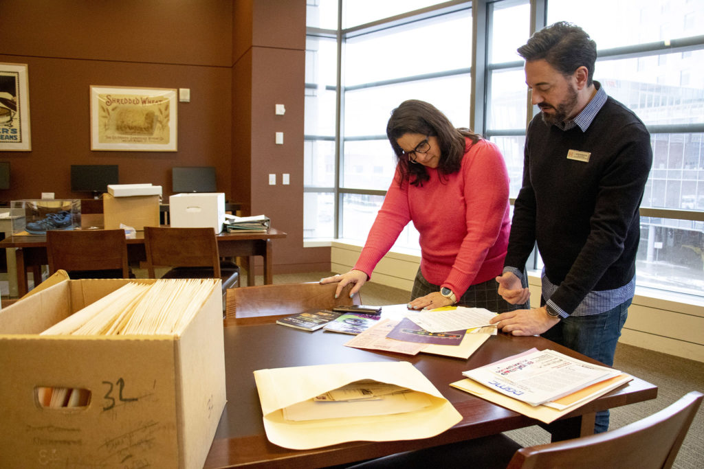 LGBTQ+ Curator Aaron Marcus and History Colorado Chief Operating Officer Dawn DiPrince sort through boxes of history inside the state archive's research library, Feb. 3, 2020. (Kevin J. Beaty/Denverite)