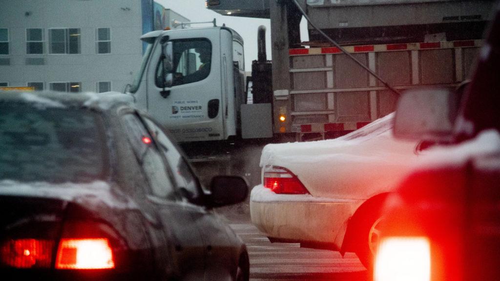 A plow amid traffic, Feb. 3, 2020. (Kevin J. Beaty/Denverite)