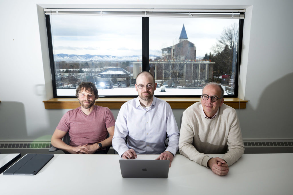 Michael Hemenway (left to right), Justin Barber and Ted Vial of the Iliff School of Theology's AI Institute pose for a portriat. Feb. 6, 2020. (Kevin J. Beaty/Denverite)