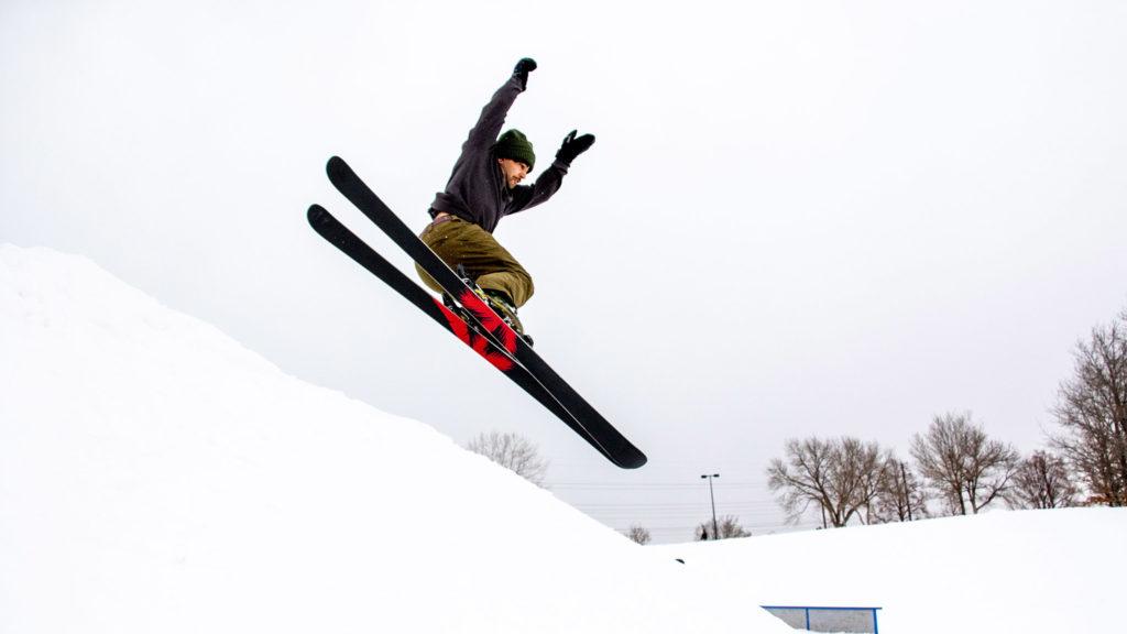 Gabe Alhussaini flies off a jump at the Ruby Hill Rail Yard, Feb. 12, 2020. (Kevin J. Beaty/Denverite)