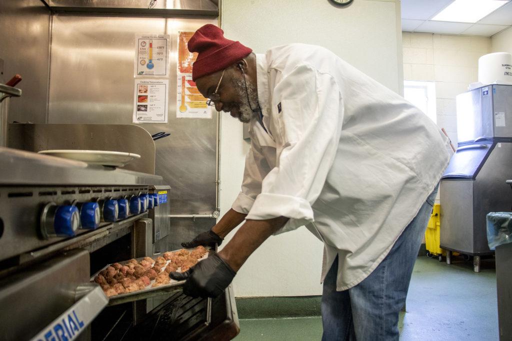 James Walker works in the kitchen at the Mental Health Center of Denver, Feb. 13, 2020. (Kevin J. Beaty/Denverite)
