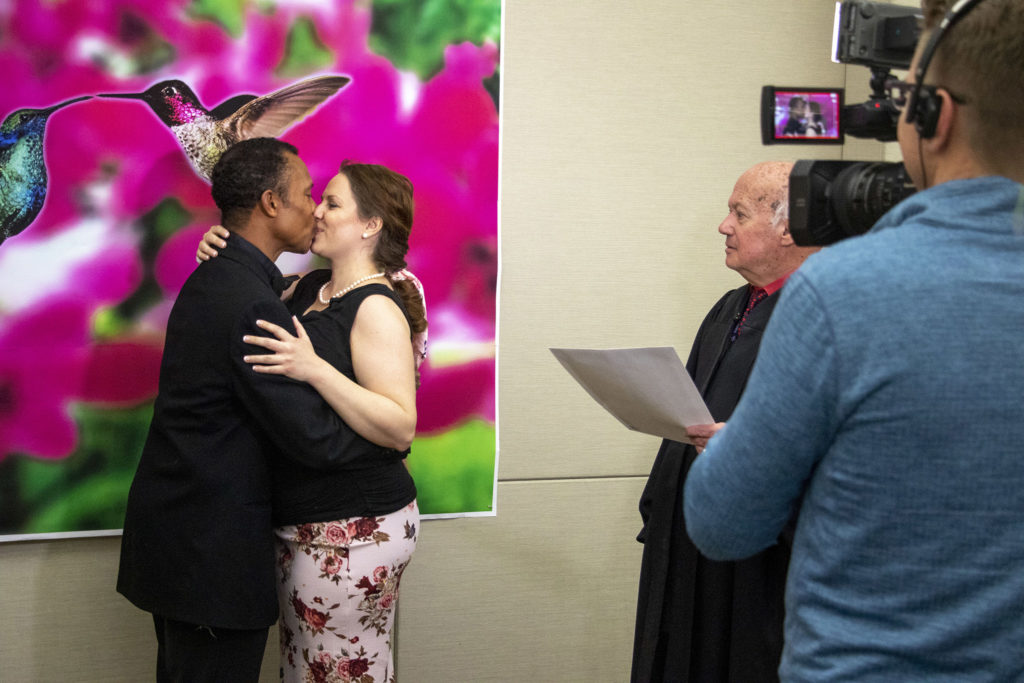 Philip Kong and Abi Steiner get hitched on Valentine's Day at the office of Denver's Clerk and Recorder, Feb. 14, 2020. (Kevin J. Beaty/Denverite)