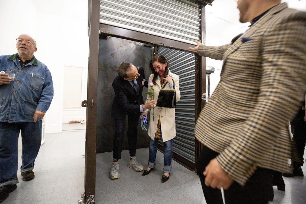 "Jeffrey Podalsky, Devon Dikeou's ""best guy friend from Brown,"" suprises her during an exhibition of her work, Feb. 20, 2020. (Kevin J. Beaty/Denverite)"