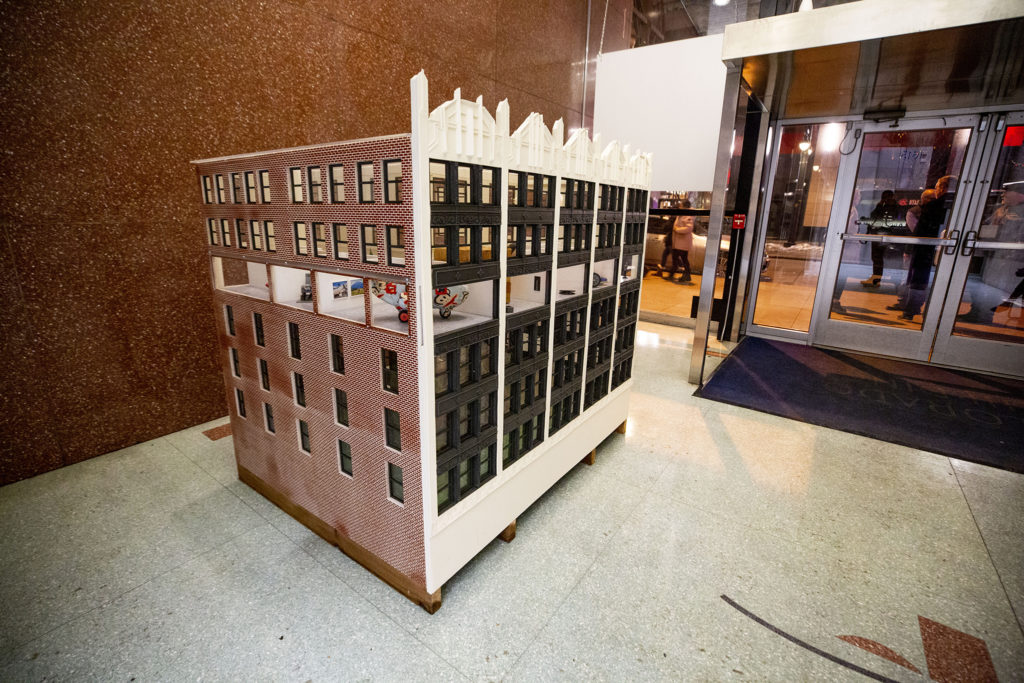 A miniature version of the Colorado Building downtown and the Dikeou Collection inside it. Feb. 20, 2020. (Kevin J. Beaty/Denverite)