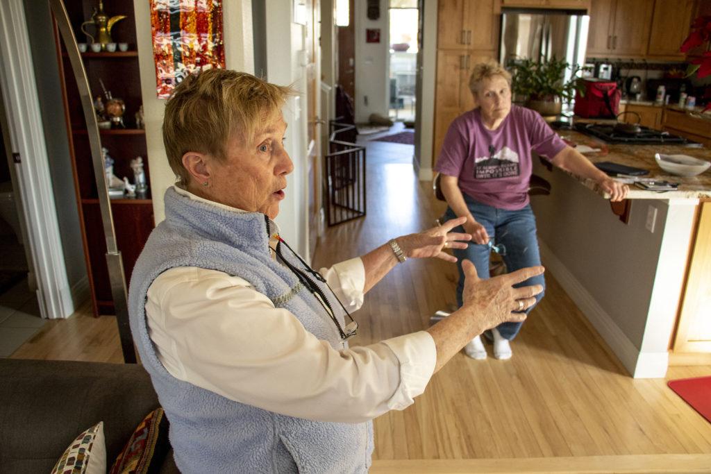 Sandy Pierce and Kari Bell in their home in the Rosedale neighborhood. Feb. 27. 2020.  (Kevin J. Beaty/Denverite)