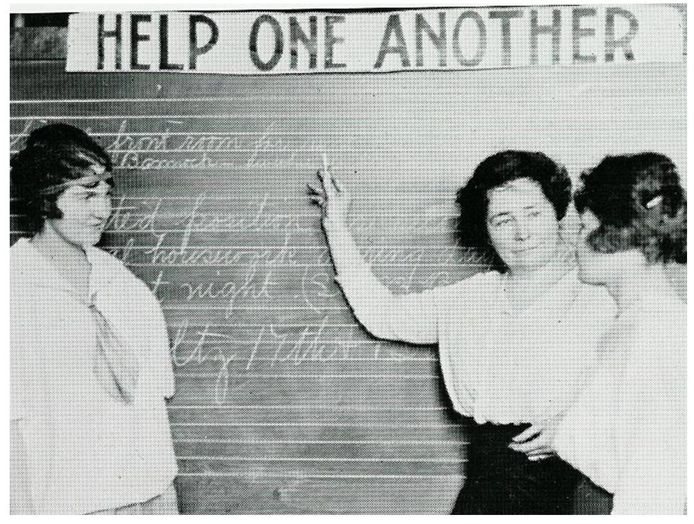This undated photo shows Emily Griffith -- center, hand raised -- with two unidentified students. (Courtesy Emily Griffith Technical College)