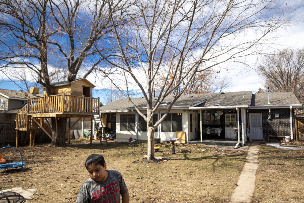 Francycso Zaldivar plays in his backyard, complete with a treehouse his father built for him. March 7, 2020. (Kevin J. Beaty/Denverite)