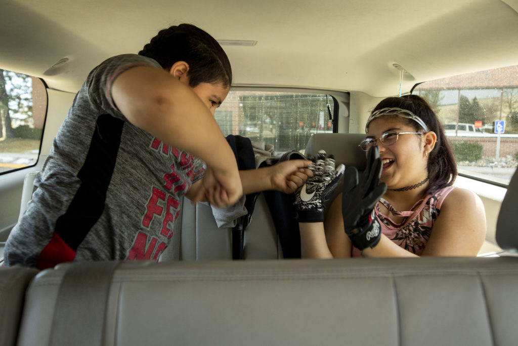 Francysco and Aanahny Zaldivar play fight in the back of their mother's SUV. March 7, 2020. (Kevin J. Beaty/Denverite)