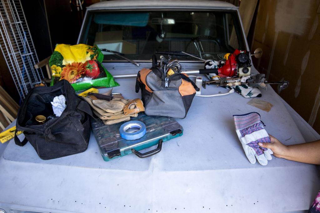 "Christina Zaldivar does ""dad work"" in her garage. March 7, 2020. (Kevin J. Beaty/Denverite)"