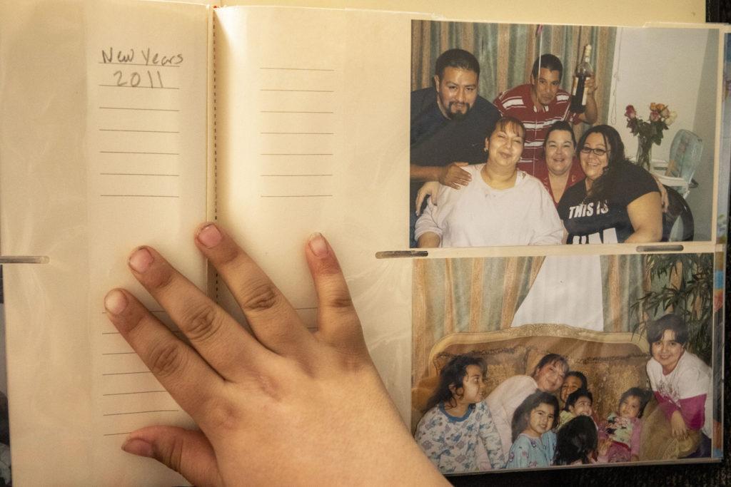 Francysco Zaldivar looks at old family photos, March 7, 2020. (Kevin J. Beaty/Denverite)