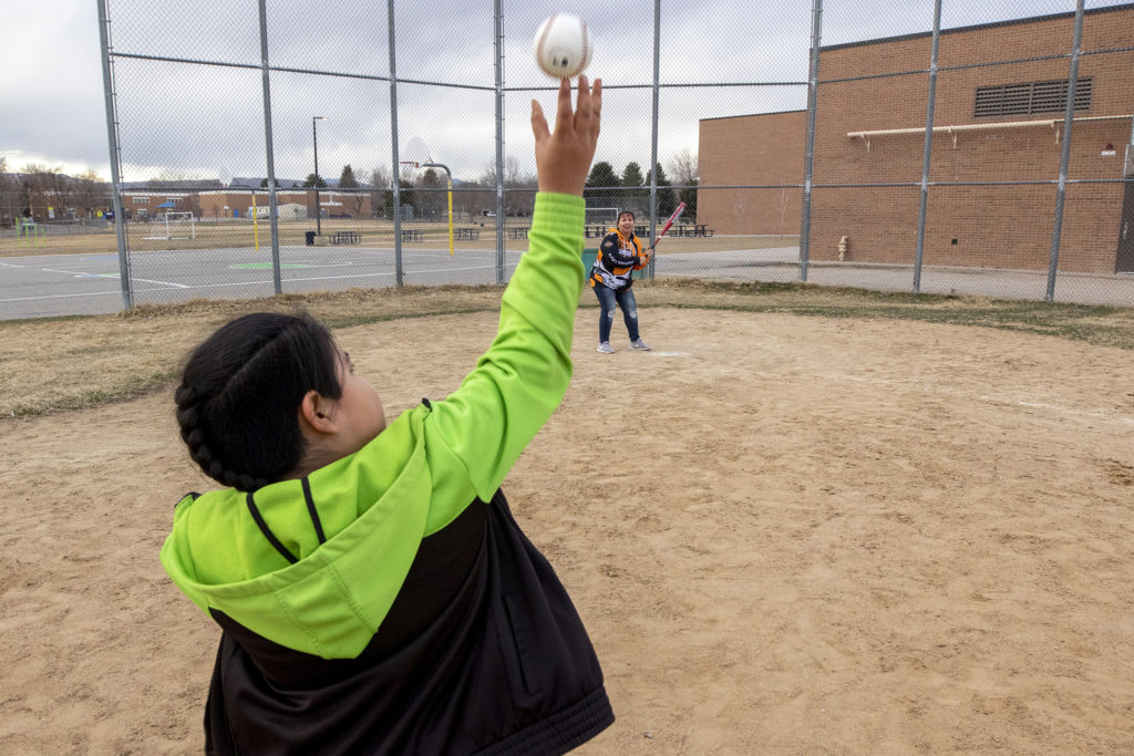 Christina Zaldivar plays baseball with her son, Francysco, in a park near their Bear Valley home. March 8, 2020. (Kevin J. Beaty/Denverite)