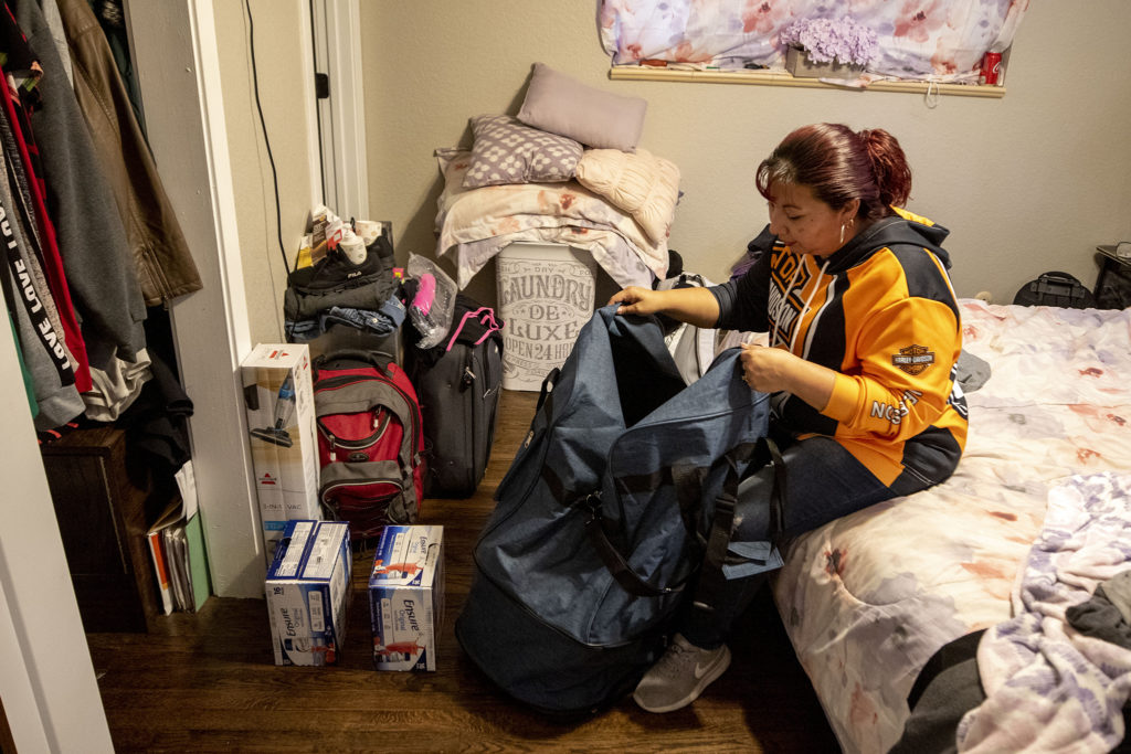 Christina Zaldivar packs her belongings for a long trip to Mexico, March 8, 2020. (Kevin J. Beaty/Denverite)
