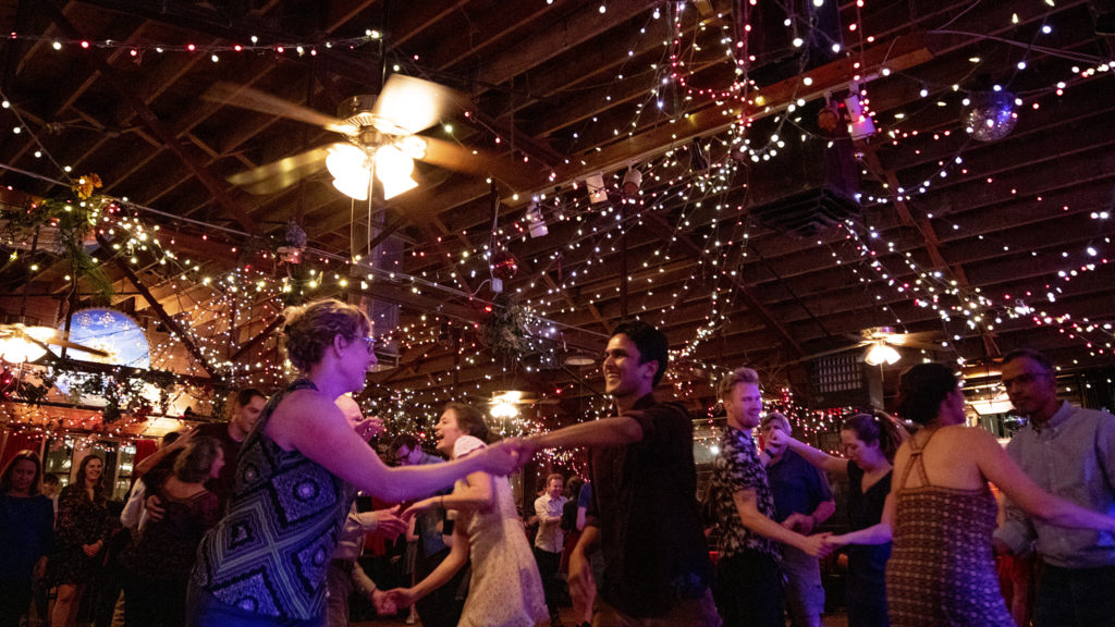 Ashwin Datt and Julia Wigert (left) swing dance at the Mercury Cafe, Five Points, March 8, 2020. (Kevin J. Beaty/Denverite)