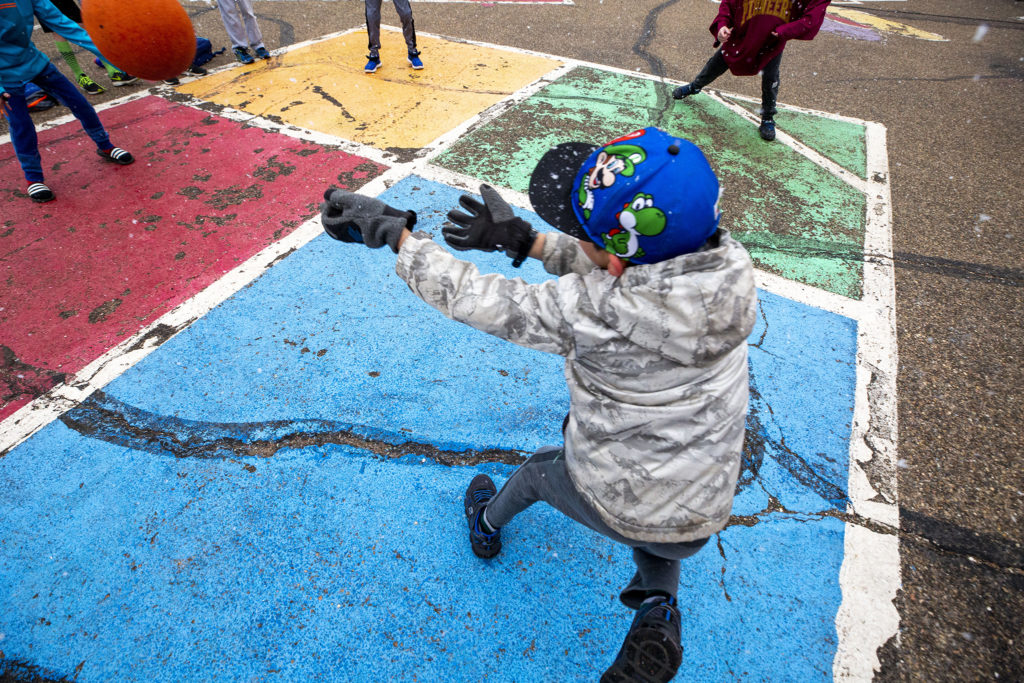 Kids play foursquare beneath light flurries before class begins at Carson Elementary, March 13, 2020. (Kevin J. Beaty/Denverite)