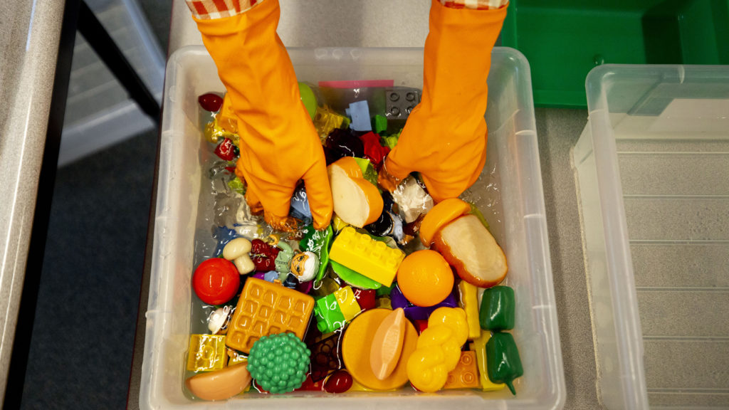 Saralyn Voltz bleaches toys in her preschool classroom at Carson Elementary, March 13, 2020. (Kevin J. Beaty/Denverite)