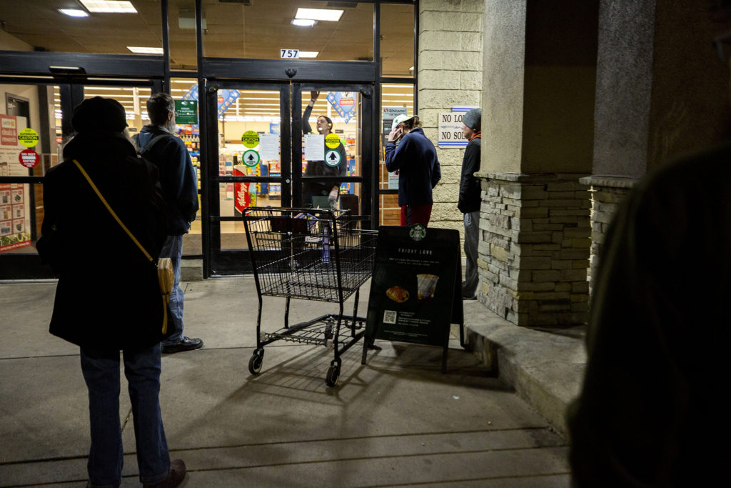 People wait to enter the Safeway on 20th Avenue as it opens for the day. March 18, 2020. (Kevin J. Beaty/Denverite)