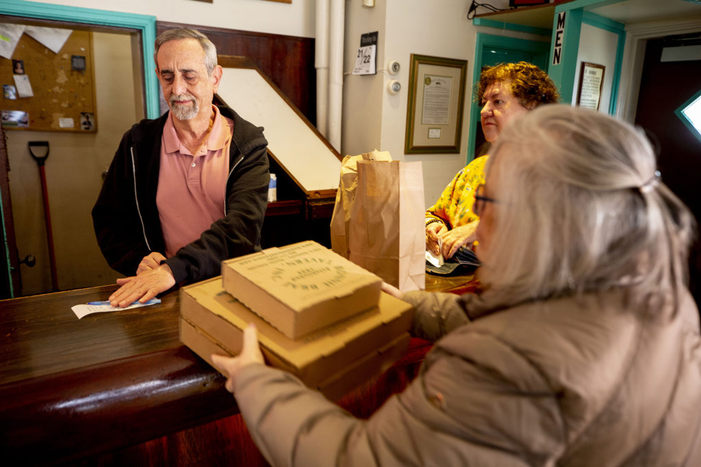 Mike Dire, owner of Bonnie Brae Tavern, prepares to-go orders at his bar. March 21, 2020. (Kevin J. Beaty/Denverite)