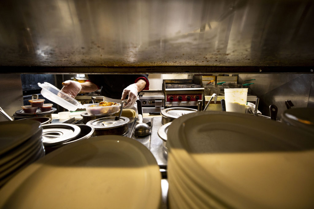 Dustin Carrera at work in Bonnie Brae Tavern's kitchen, March 21, 2020. (Kevin J. Beaty/Denverite)