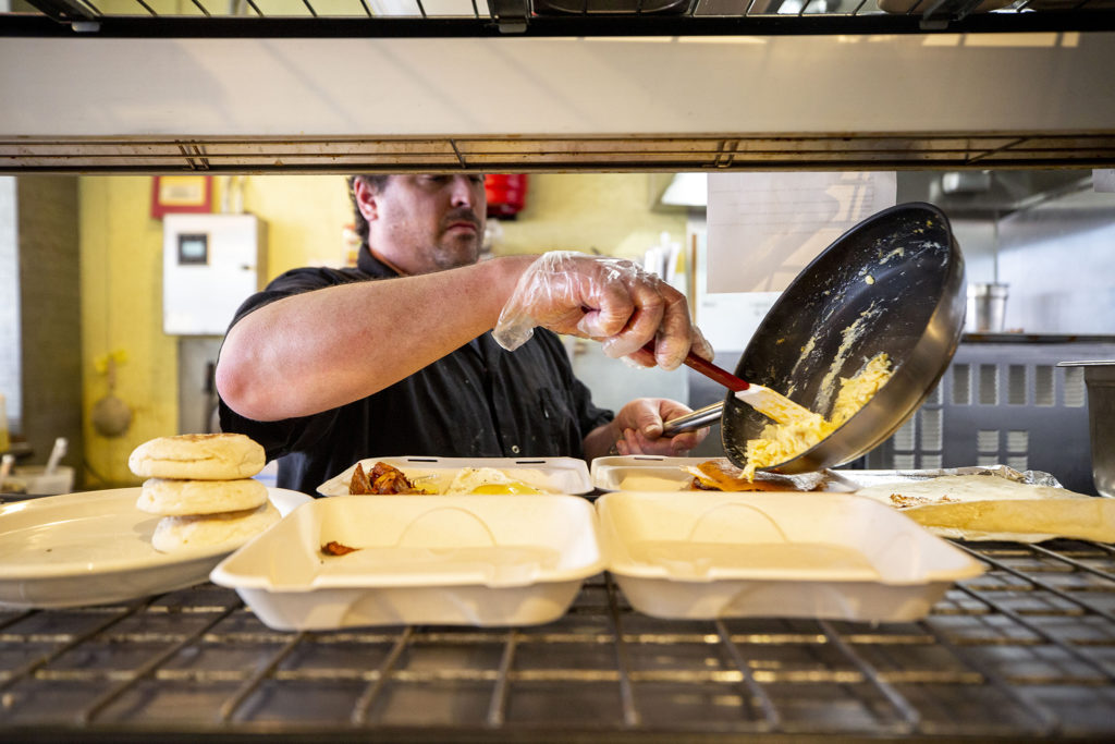 Ryan Turano, owner of Sunny's in Sunnyside, makes to-go orders. March 21, 2020. (Kevin J. Beaty/Denverite)