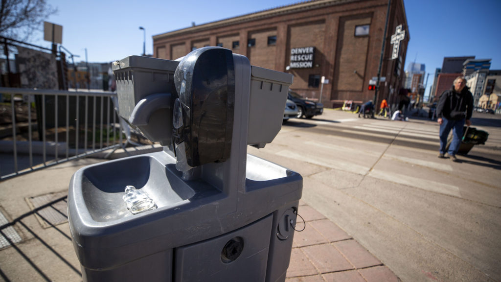 A hand sanitizing station across the street from the Denver Rescue Mission and Samaritan House shelters. March 24, 2020. (Kevin J. Beaty/Denverite)