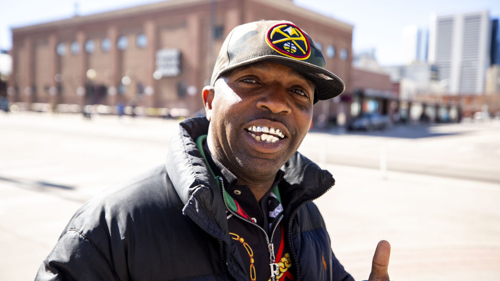 Scott poses for a photo across the street from the Denver Rescue Mission. March 24, 2020. (Kevin J. Beaty/Denverite)