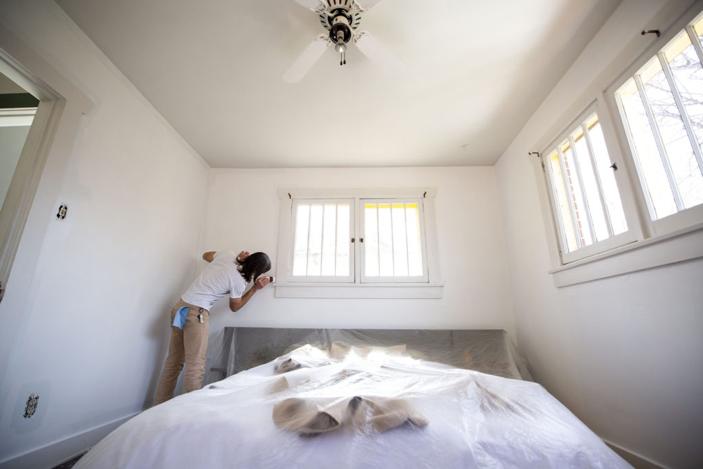 Eric Robert Dallimore, founder and artistic director of Leon Gallery, takes time to paint his bedroom while a shelter-in-place order is in effect for Denver. Congress Park, March 25, 2020. (Kevin J. Beaty/Denverite)