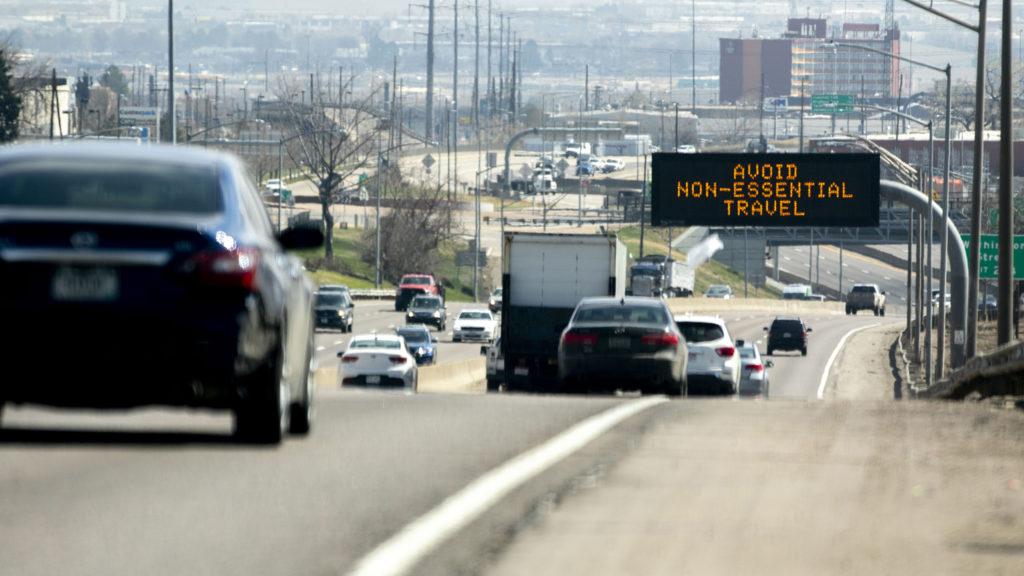 """Avoid non-essential travel."" I-70, March 26, 2020. (Kevin J. Beaty/Denverite)"